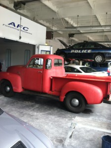 Vintage truck entering the paint booth
